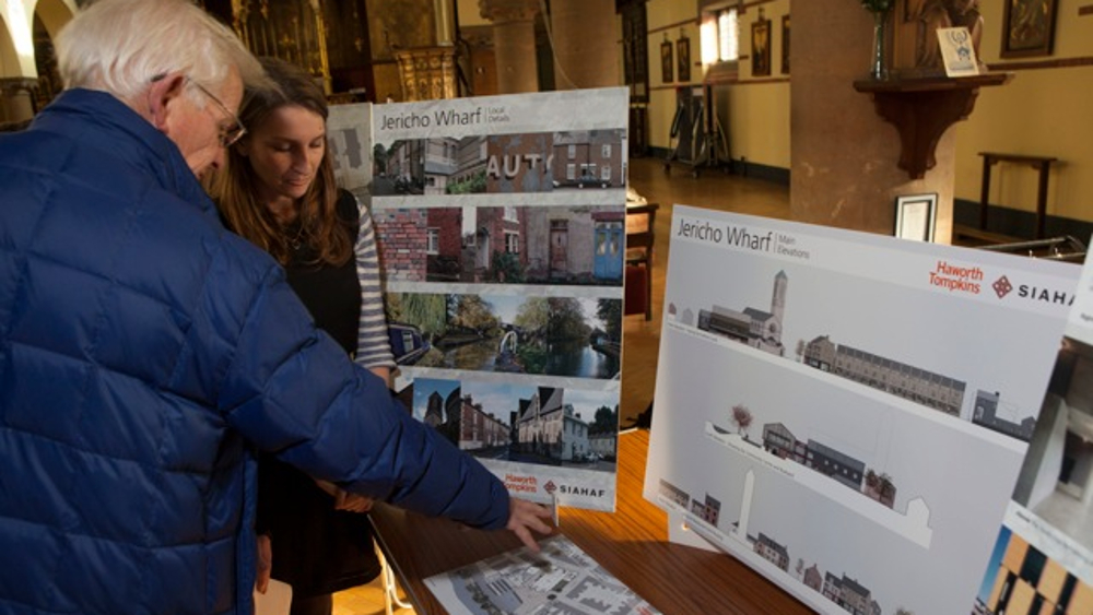 <p>Local residents discuss SIAHAF plans at a consultation in St Barnabas Church, February 2014</p>