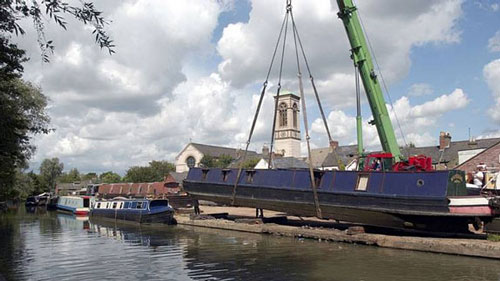 <p>Boater owners were able to have their canalboats craned out of the water for repair - © Adrian Arbib</p>